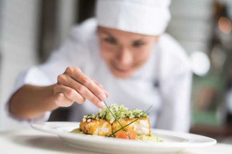 A chef plates a dish