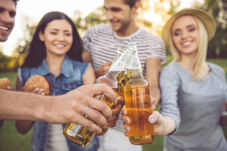 A group of friends enjoys ciders