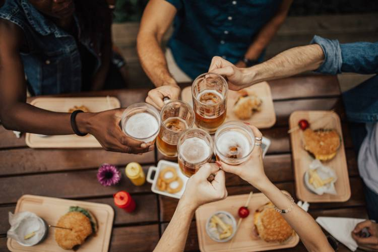 Friends enjoy beers at a local brewery