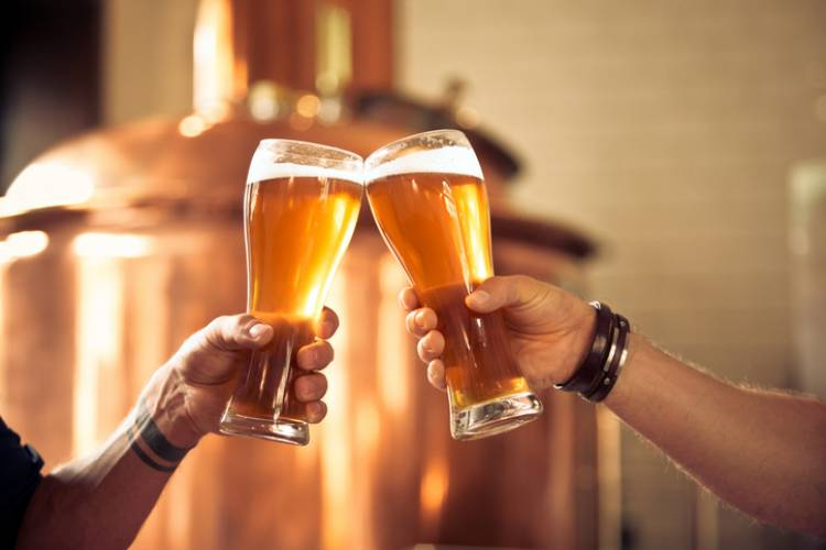 Friends cheers at a local brewery