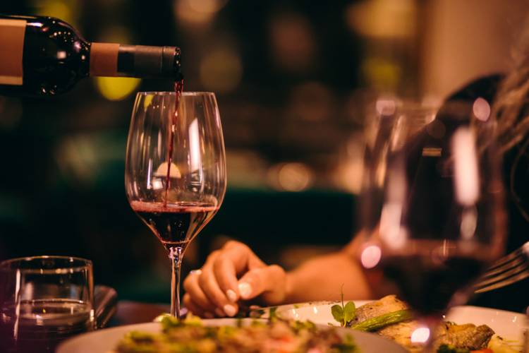 Wine is poured at a fine dining restaurant