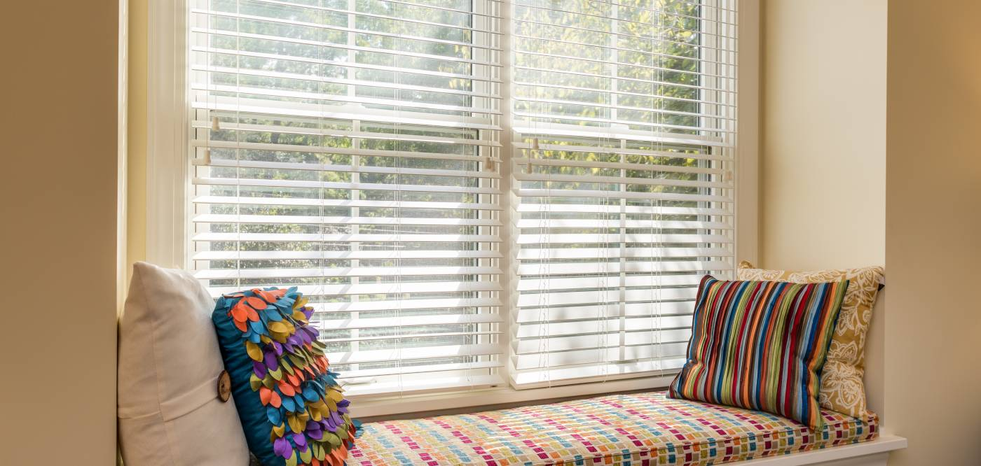 Beautifully decorated window bench overlooking a scenic view of Charlottesville in an extended stay accommodation for Guesthouses