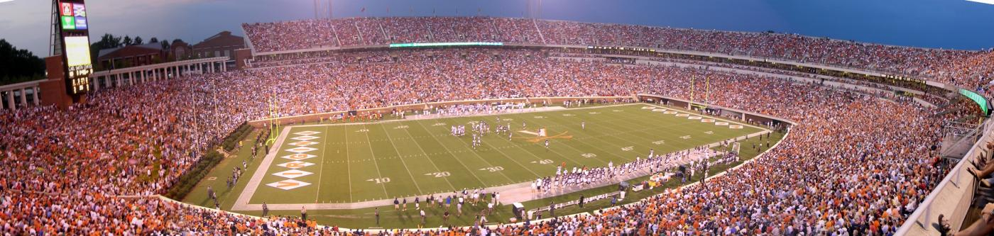 A night shot of a packed UVA home football game at Scott Stadium